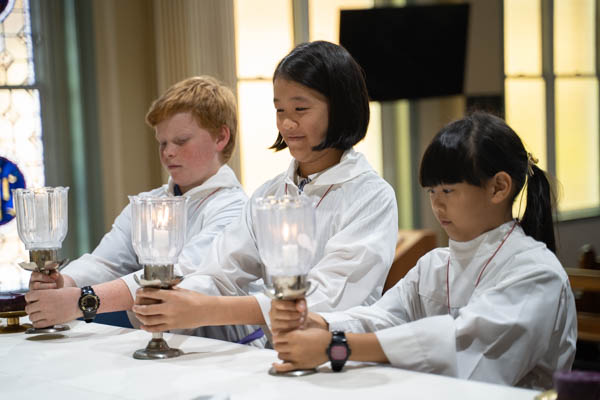 St Raphael Catholic Primary School South Hurstville students assisting during mass